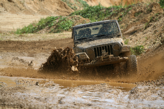 4x4 offroad vehicle driving in mud